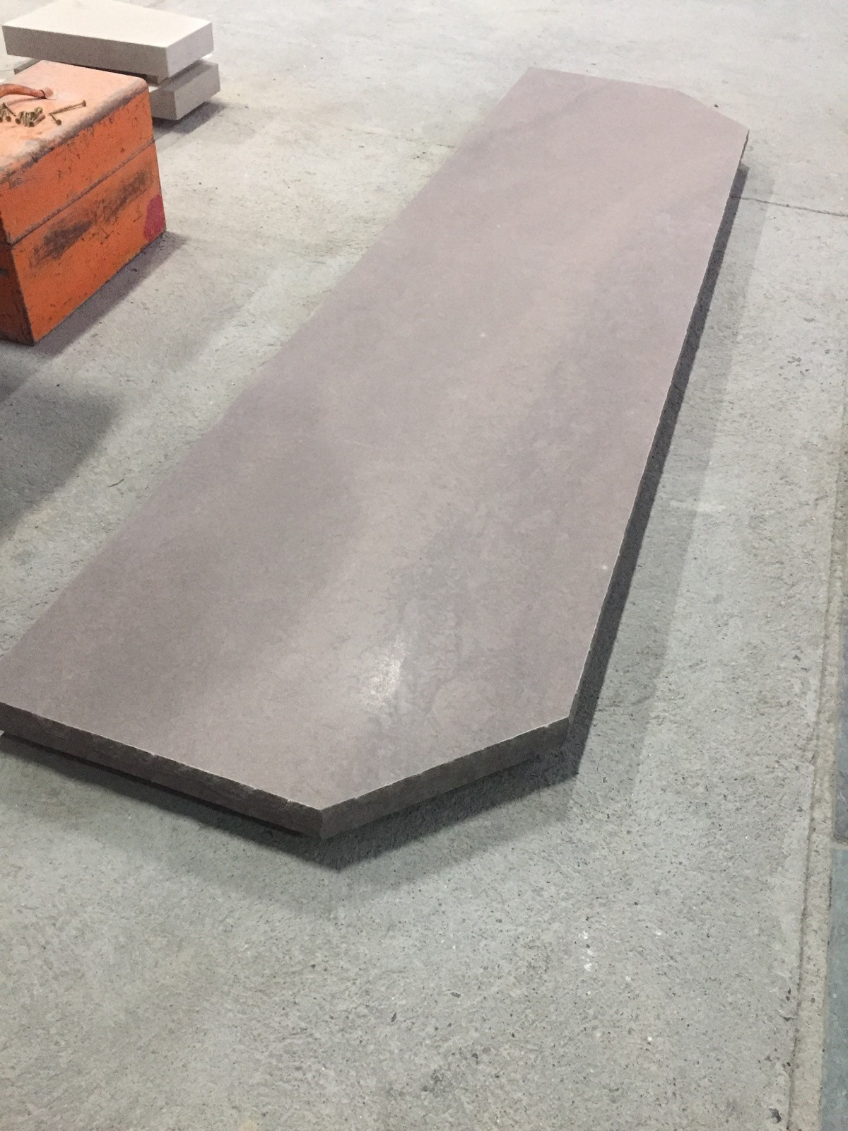 Brown wave sandstone with honed top and rocked edges